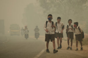 Students walk along a street as they are released from school to return home earlier due to the haze in Jambi, Indonesia's Jambi province, September 29, 2015 in this file picture taken by Antara Foto. Antara Foto/Wahdi Setiawan/via REUTERS/File Photo ATTENTION EDITORS - THIS IMAGE WAS PROVIDED BY A THIRD PARTY. FOR EDITORIAL USE ONLY. MANDATORY CREDIT. INDONESIA OUT. - RTSOJCY